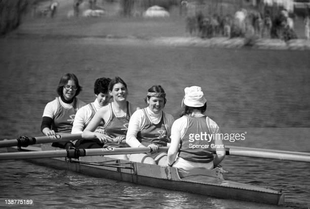 Boston University women's crew team practice on the Charles River Boston Massachusetts 1975