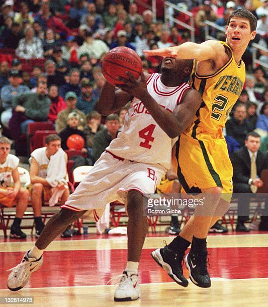 Boston University's LeVar Folk is blocked by University of Vermont's David Roach during Sunday's game at Boston University