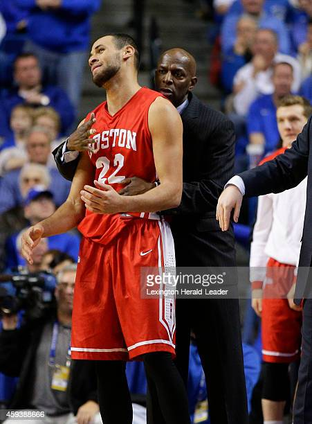 Boston University's Nathan Dieudonne is consoled by head coach Joe Jones amid an 8965 loss against Kentucky on Friday Nov 21 at Rupp Arena in...