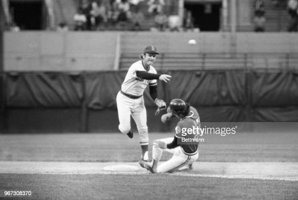 Boston's Denny Doyle fires to first base to complete double play during 4th inning of game. Sliding into second is Cleveland's Rick Manning.