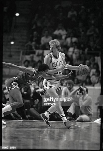 Boston's forward Larry Bird carries the ball to the outside as Bulls' guard Dudley Bradley attempts the steal 1/31
