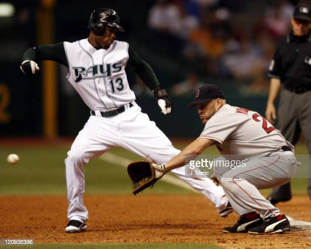 Boston's Kevin Youkilis prepares for this throw as Tampa Bay's Carl Crawford slides safely back to first during Friday night's action at Tropicana...