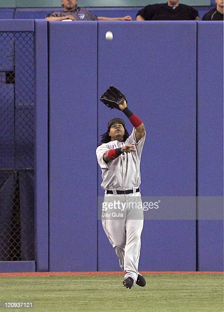 Boston's LF Manny Ramirez catches a fly ball for an out in game between the Boston Red Sox vs the Toronto Blue Jays at Rogers Centre in Toronto...