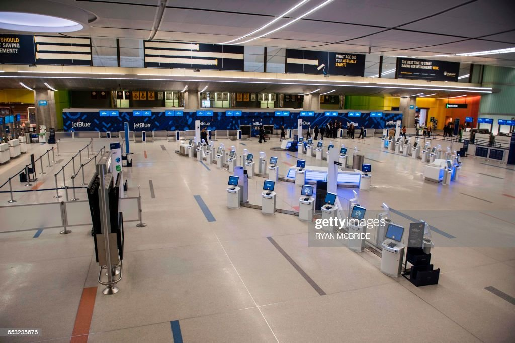 Boston's Logan International Airport C terminal is quieter than usually as a major snow storm has cancelled most of the flights inbound and outbound March 14, 2017. Winter Storm Stella dumped snow and sleet Tuesday across the northeastern United States where thousands of flights were canceled and schools closed, but appeared less severe than initially forecast. PHOTO / Ryan McBride