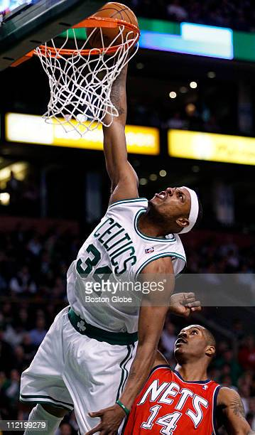 Boston's Paul Pierce dunks the ball with authority over the Nets' Derrick Favors in the 1st quarter The Boston Celtics play the New Jersey Nets at...