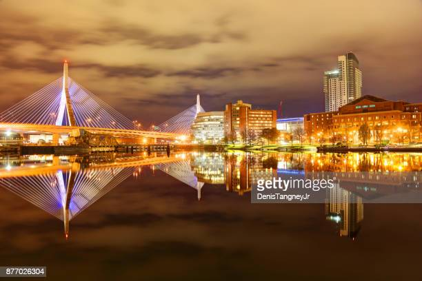 boston's zakim bridge reflection on the charles river - boston stock pictures, royalty-free photos & images