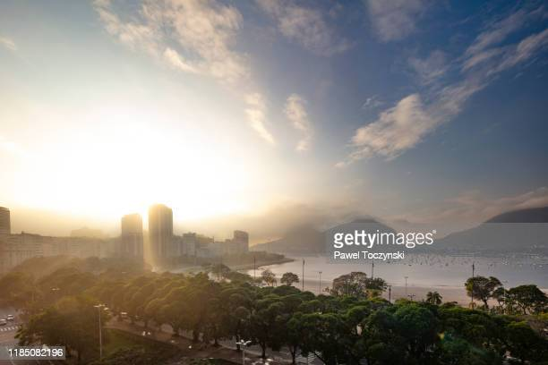 botafogo bay overlooking sugarload mountain on an overcast day at sunrise, rio de janeiro, brazil - botafogo brazil stock pictures, royalty-free photos & images