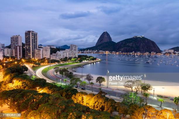 botafogo bay overlooking sugarload mountain on an overcast day at dusk, rio de janeiro, brazil - botafogo brazil stock pictures, royalty-free photos & images
