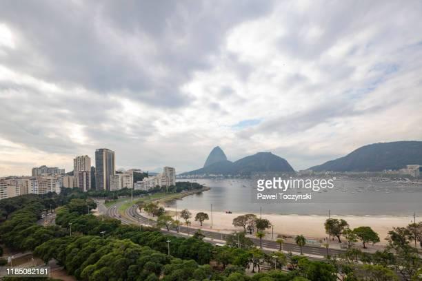 botafogo bay overlooking sugarload mountain on an overcast day, rio de janeiro, brazil - botafogo brazil stock pictures, royalty-free photos & images