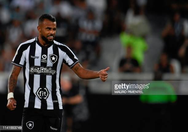 Botafogo's player Alex Santana celebrates after scoring against Fortaleza during their Brazilian Championship football match at the Nilton Santos...