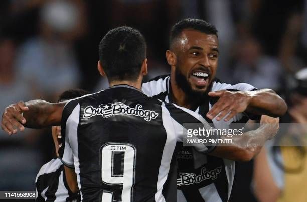 Botafogo's player Alex Santana celebrates with a teammate after scoring against Fortaleza during their Brazilian Championship football match at the...
