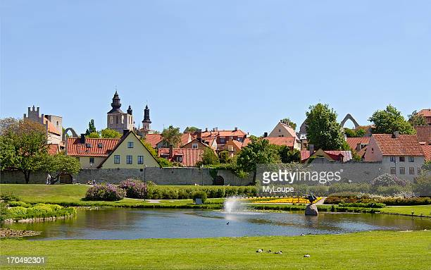 Botanical Garden in Harbor town of Visby on the Island of Gotland in Sweden In the middle of the garden is a lake with a fountain and in the...