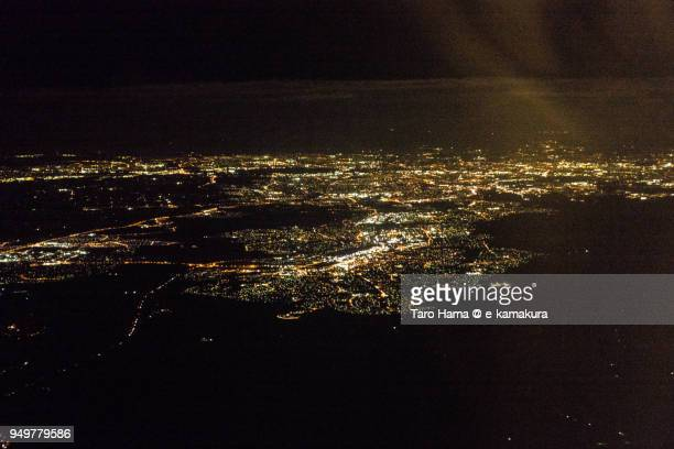 Botany Bay and Sydney city in Australia, night time aerial view from airplane