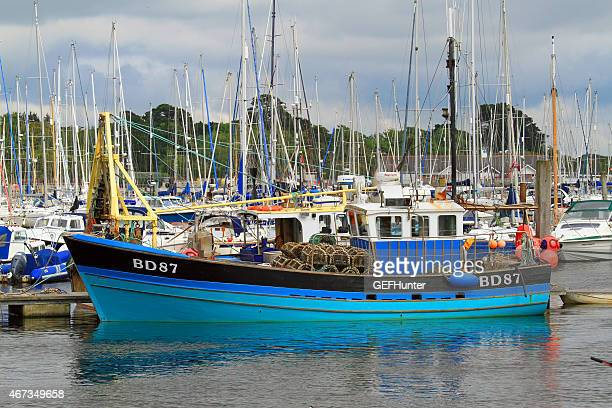 botas floatng in lymington harbour - lymington stock photos and pictures