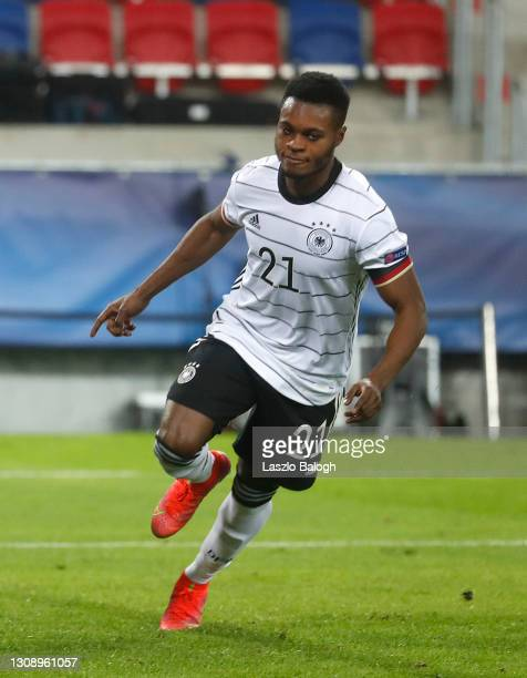 Bote Baku of Germany celebrates after scoring his sides second goal during the 2021 UEFA European Under-21 Championship Group A match between Hungary...