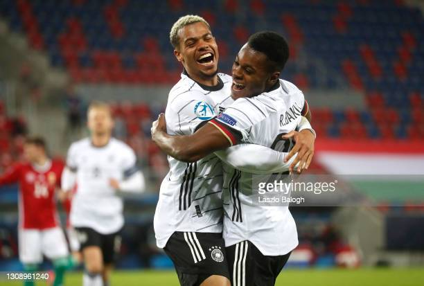 Bote Baku of Germany celebrates with teammate Lukas Nmecha after scoring his sides second goal during the 2021 UEFA European Under-21 Championship...