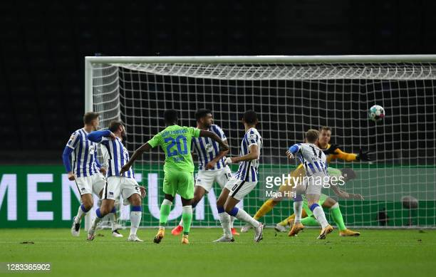 Bote Baku of VfL Wolfsburg scores his sides first goal during the Bundesliga match between Hertha BSC and VfL Wolfsburg at Olympiastadion on November...