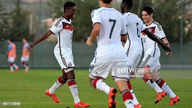 Bote Nzuzi Baku of Germany celebrates with team mates after scoring his team's second goal during the U18 four nations friendly tournament match...