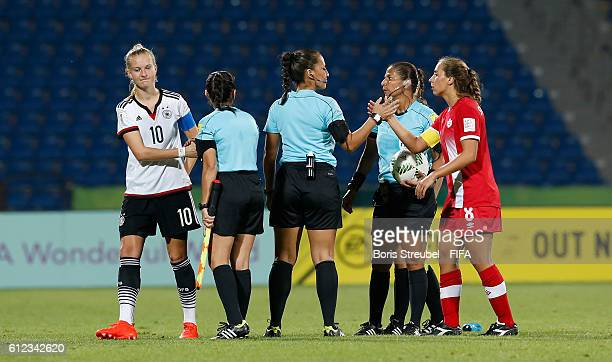 Both Captain and the referee's meet for the handshake of peace after the FIFA U17 Women's World Cup Jordan Group B match between Germany and Canada...