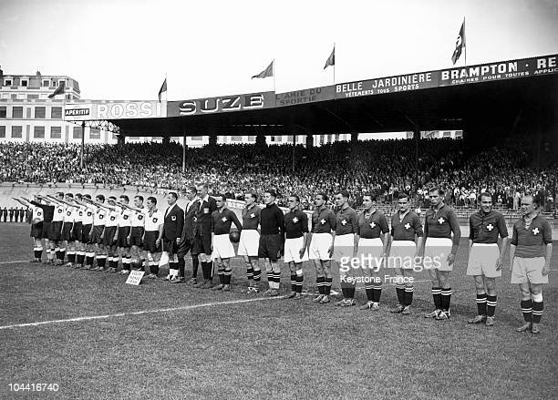 Both football teams Germany and Switzerland greeting each other before their match as a prelude to the World Cup football at the Parc des Princes on...