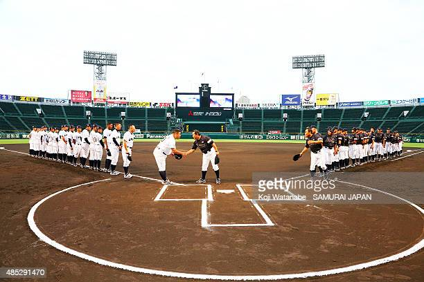 Both Japan teams line up for national anthem in the send-off game between U-18 Japan and Collegiate Japan before the 2015 WBSC U-18 Baseball World...