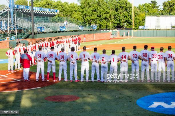 Both North Carolina State and Indiana line up for the National Anthem during the Lexington Regional College World Series baseball game between the...
