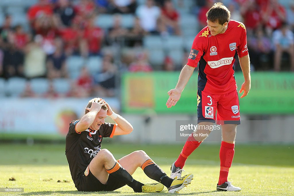 Both players react after Besart Berisha of Brisbane was brought down by Nigel Boogaard of Adelaide during the round 23 A-League match between Adelaide United and the Brisbane Roar at Hindmarsh Stadium on March 2, 2013 in Adelaide, Australia.