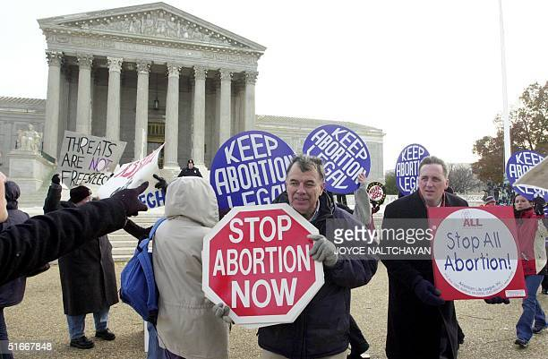 Both prochoice and prolife activists demonstrate in front of the US Supreme Court 04 December as oral arguments are being heard inside on the...