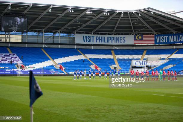 Both sets of players observe a 2 minute silence in memory of the passing of the Duke of Edinburgh before the Sky Bet Championship match between...