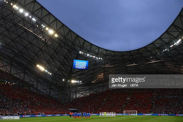 Both sides come together for the minutes applause during the UEFA EURO 2016 Group A match between France and Albania at Stade Velodrome on June 15,...