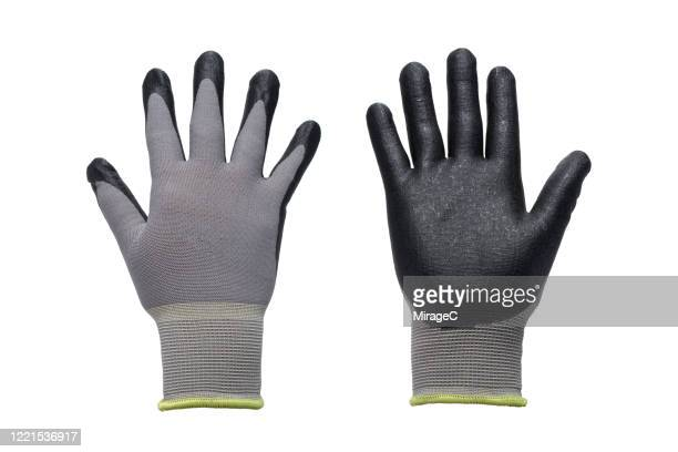 both sides of gray work gloves - work glove stock pictures, royalty-free photos & images