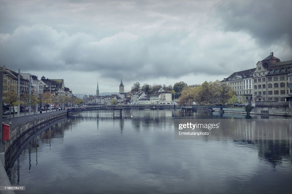 Both sides of Limmat river on a cloudy day. : Stock Photo