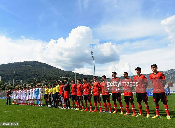 Both team line up before kick off during the Toulon Tournament Group A match between China PR and Mexico at the Leo Legrange Stadium on May 29, 2014...