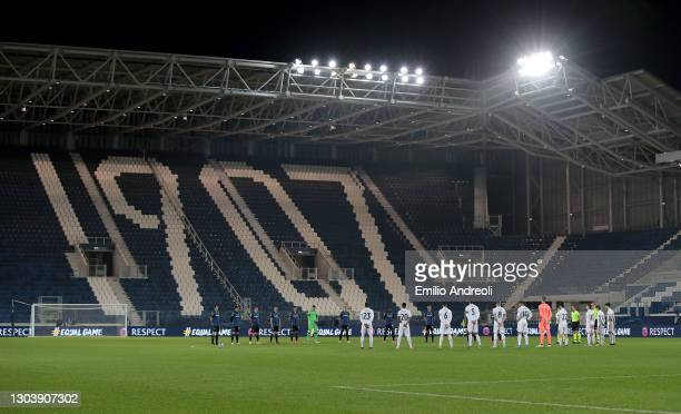 Both team's and Official's stand for a minute's silence in memory of the victims of COVID 19 who have passed away prior to the UEFA Champions League...
