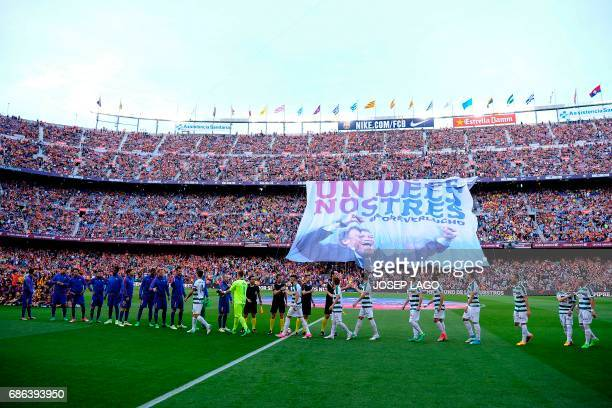 Both teams cheer each other as a big banner as a tribute to Barcelona's coach Luis Enrique reading in Catalan 'For ever one of ours' is unfolded...