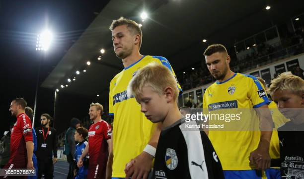Both teams come into the stadium here Julian GuentherSchmidt and Niclas Erlbeck of Jena during the third Liga match between FC Carl Zeiss Jena and...