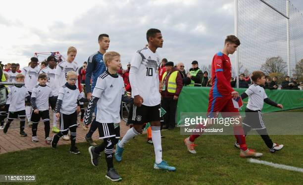 Both teams come into the stadium, here Mattes Hansen, Goalkeeper Mio Backhaus, Melkamu Frauendorf of Germany and Daniel Samek of Czech Republic...