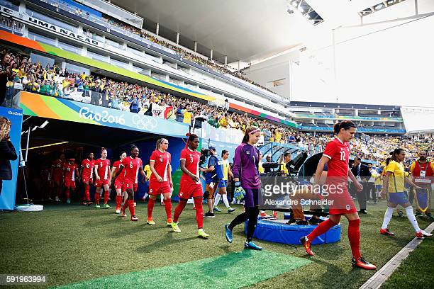 Both teams enter the field before the Women's Olympic Football Bronze Medal match between Brazil and Canada at Arena Corinthians on August 19 2016 in...