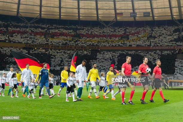 Both teams enter the field prior to the international friendly match between Germany and Brazil at Olympiastadion on March 27 2018 in Berlin Germany