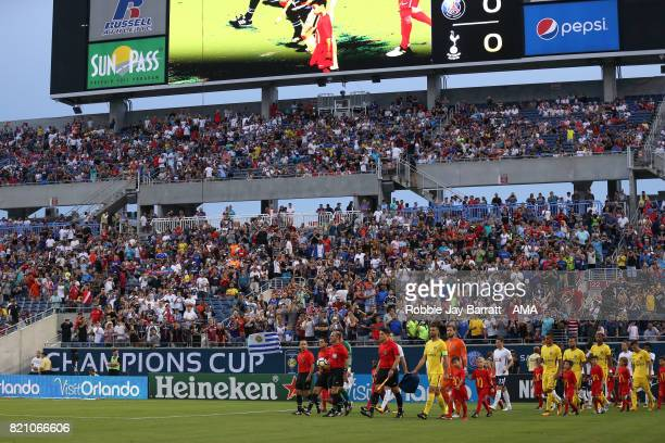 Both teams enter the pitch during the International Champions Cup match between Paris SaintGermain and Tottenham Hotspur on July 22 2017 in Orlando...