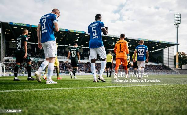 Both teams enter the pitch during the Second Bundesliga match between SV Darmstadt 98 and SV Werder Bremen at Merck-Stadion am Boellenfalltor on...