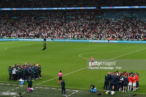 Both teams form huddle before the start of the second half of extra time during the UEFA Euro 2020 Championship Final between Italy and England at...