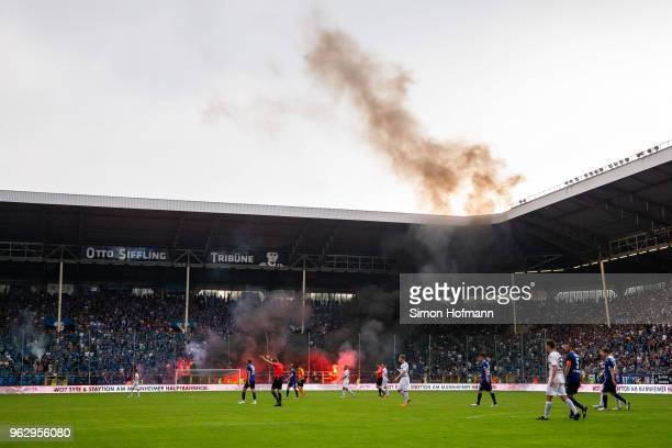 Both teams leave the pitch as the match is interrupted during the Third League Playoff Leg 2 match between SV Waldhof Mannheim and KFC Uerdingen at...