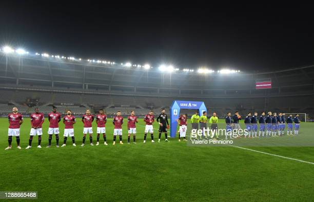 Both teams line up as Armando Izzo of Torino F.C. Holds up a number 10 shirt in memory of Diego Maradona ahead of the Serie A match between Torino FC...