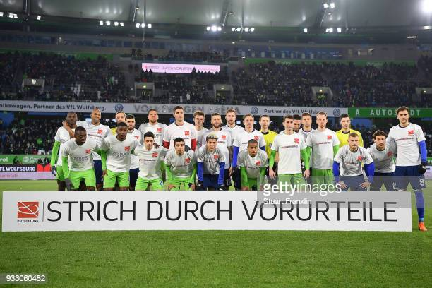Both teams line up behind a banner against discrimination and for the campaign 'Say No to prejudice' an antidiscrimination campaign before the...