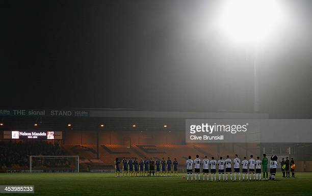 Both teams line up for a minutes applause in memory of Nelson Mandela prior to the FA Cup Second Round match between Port Vale and Salisbury City at...