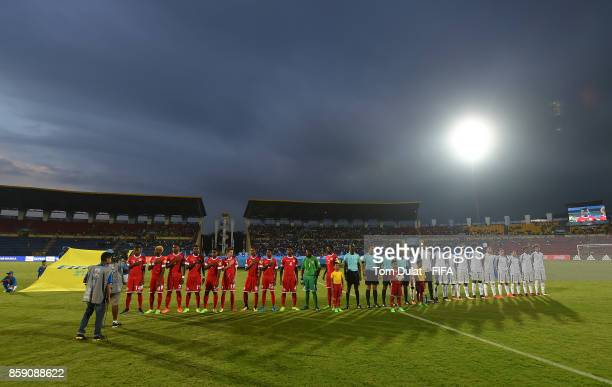 Both teams line up for national anthems prior to the FIFA U17 World Cup India 2017 group E match between New Caledonia and France at Indira Gandhi...
