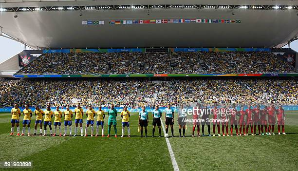 Both teams line up for their national anthem before the Women's Olympic Football Bronze Medal match between Brazil and Canada at Arena Corinthians on...