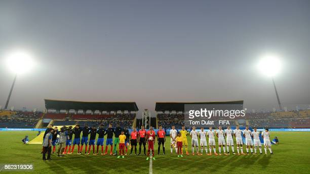 Both teams line up for their national anthems prior to the FIFA U17 World Cup India 2017 Round of 16 match between France and Spain at Indira Gandhi...
