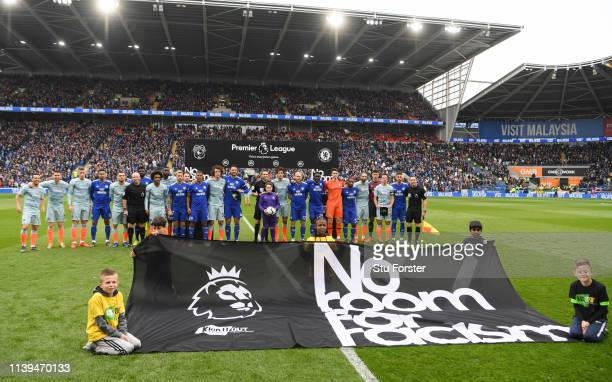 Both teams line up in front of the No room for racism sign ahead of the Premier League match between Cardiff City and Chelsea FC at Cardiff City...